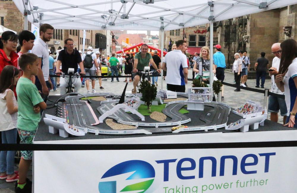 01-tennet-technikmeile-nuernberg-fahrradangetriebene-carrerabahn-netzbetreiber-obu